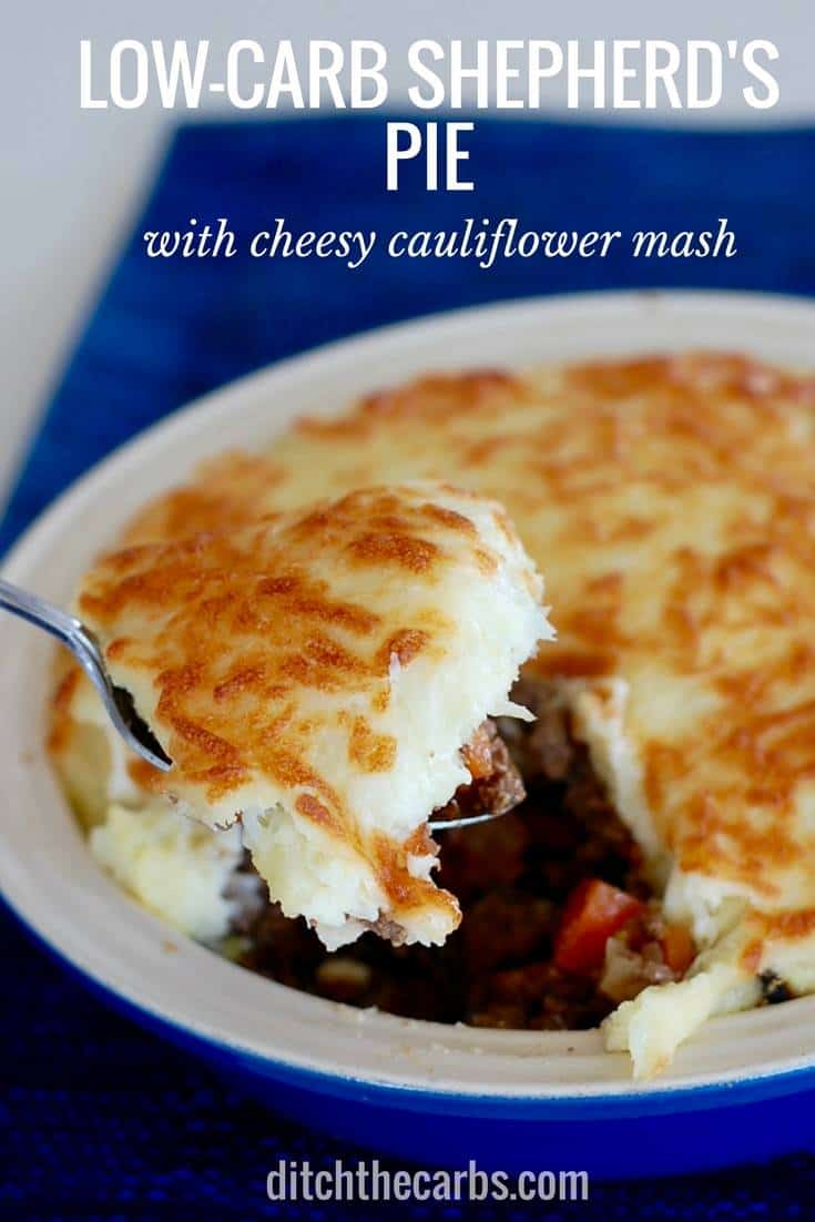 Low-carb shepherd's pie with a cheesy cauliflower crust is an absolute low-carb family staple. #lowcarb #familydinner #healthydinner #casserole #glutenfree #keto #mashedcauliflower