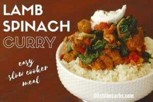 Low carb lamb curry with spinach, in the slow cooker. Pin for later because it's an easy mid week dinner. Serve with low-carb cauliflower rice for the perfect meal. #lowcarbdinner #ketodinner #healthyfamilydinner #ketocurry #lowcarbcurry