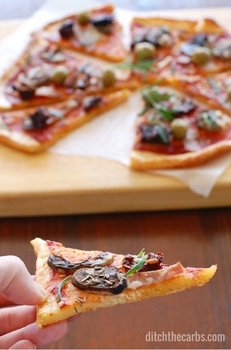 You have seriously got to try the best and easiest recipe for low carb pizza out there - Fat Head pizza. It's low carb, wheat free, gluten free and the easiest recipe you'll find. Googles top low carb pizza. #lowcarb #wheatfree #sugarfree #glutenfree | ditchthecarbs.com