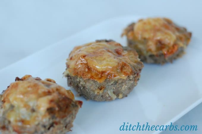 A fabulous recipe for meatloaf cupcakes. Topped with melted cheese makes these little bundles a great snack idea, lunch or for the school lunch boxes. Make a double batch and freeze them so you're ready for the next few weeks. Gluten free, grain free and low carb. | ditchthecarbs.com