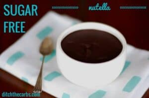 Sugar-Free Nutella on a folded blue and white napkin with silver spoon