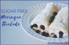 simple sugar-free meringue roulade served with whipped cream and berries