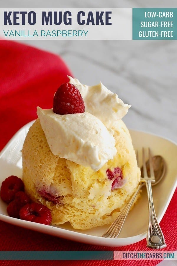 keto vanilla berry mug cake served with silver fork and spoon on a folded red napkin