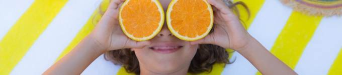 banner showing child holding oranges