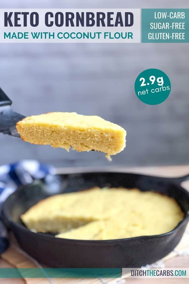 A triangle slice of keto cornbread is being lifted out of a cast-iron skillet on a metal spatula.